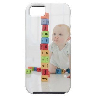 Baby on floor looking at stacked wood blocks iPhone 5 cases