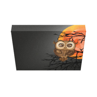 Baby owl with big eyes. canvas print