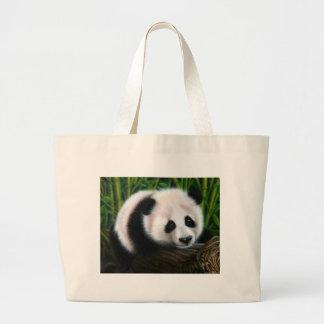 Baby panda balancing on a log canvas bags