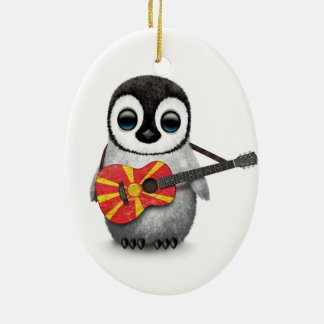 Baby Penguin Playing Macedonian Flag Guitar Ceramic Oval Decoration