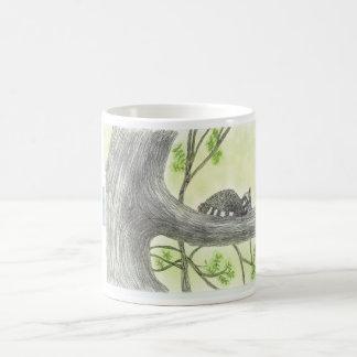 Baby raccoon asleep in a tree coffee mug