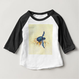 Baby sea turtle emerging from the sand baby T-Shirt