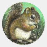 Baby squirrel and cones round sticker