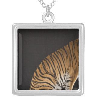 Back end of tiger sitting on platform silver plated necklace