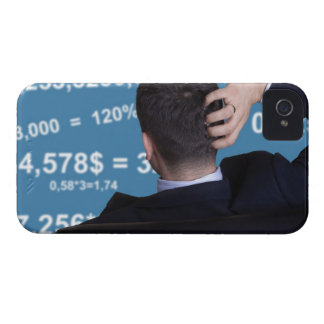Back portrait of a businessman confused with iPhone 4 case
