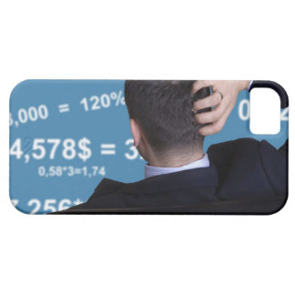 Back portrait of a businessman confused with iPhone 5 case