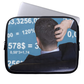 Back portrait of a businessman confused with laptop sleeve