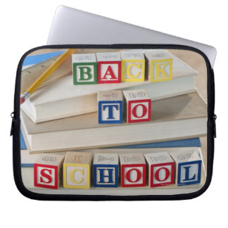 Back to school building blocks on stacked books laptop sleeve