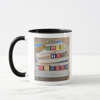 Back to school building blocks on stacked books mug