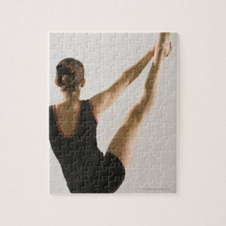 Back view of flexible gymnast jigsaw puzzle