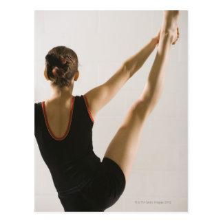 Back view of flexible gymnast postcard