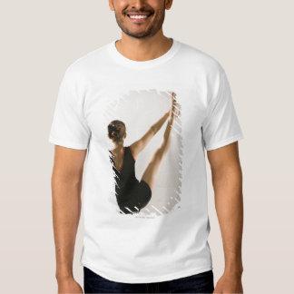 Back view of flexible gymnast tshirts