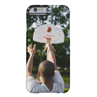 Back view of man shooting basketball outdoors barely there iPhone 6 case