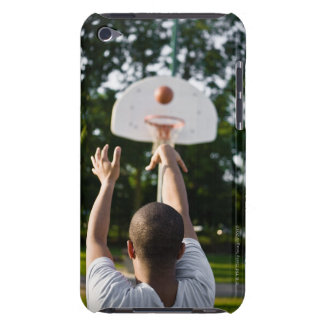 Back view of man shooting basketball outdoors barely there iPod covers