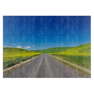Backcountry road through Spring Canola Fields Cutting Board