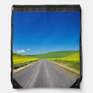 Backcountry road through Spring Canola Fields Drawstring Bag