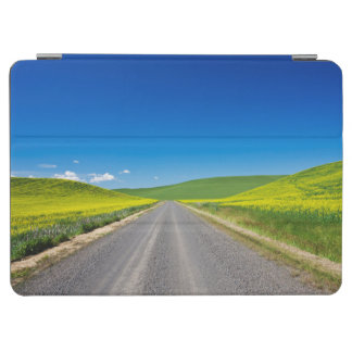 Backcountry road through Spring Canola Fields iPad Air Cover