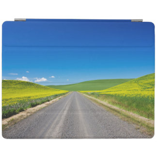 Backcountry road through Spring Canola Fields iPad Cover