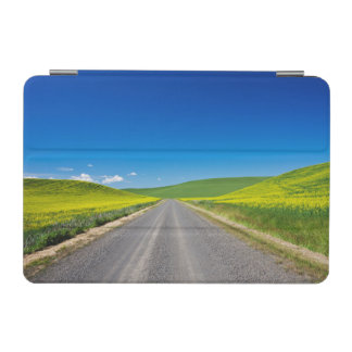 Backcountry road through Spring Canola Fields iPad Mini Cover
