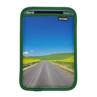 Backcountry road through Spring Canola Fields iPad Mini Sleeve