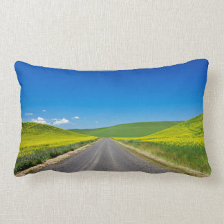 Backcountry road through Spring Canola Fields Lumbar Cushion