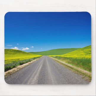 Backcountry road through Spring Canola Fields Mouse Mat
