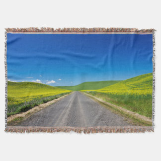 Backcountry road through Spring Canola Fields Throw Blanket