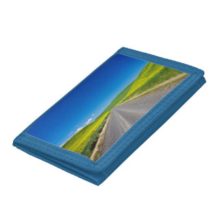 Backcountry road through Spring Canola Fields Trifold Wallet