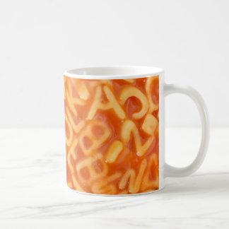 Background of alphabet shaped spaghetti coffee mug