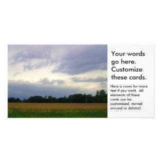 Bad weather approaching farm fields storm clouds card