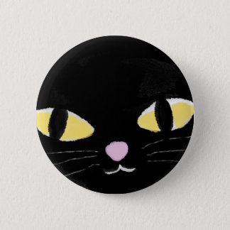 Badge with cat's eyes.