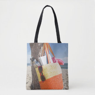 Bag Hanging On Tree Trunk At Sandy Beach
