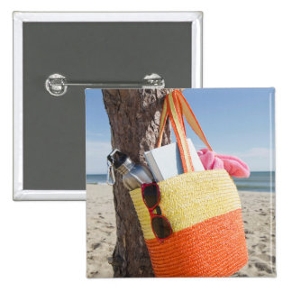 Bag Hanging On Tree Trunk At Sandy Beach 15 Cm Square Badge