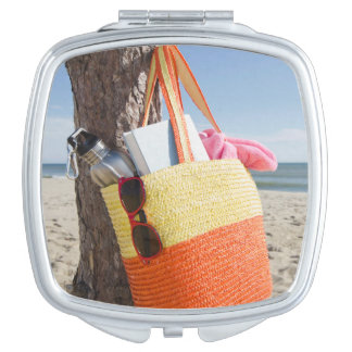 Bag Hanging On Tree Trunk At Sandy Beach Compact Mirrors