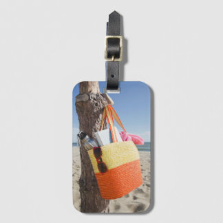 Bag Hanging On Tree Trunk At Sandy Beach Luggage Tag