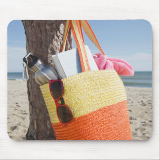 Bag Hanging On Tree Trunk At Sandy Beach Mouse Pad