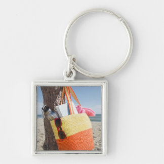 Bag Hanging On Tree Trunk At Sandy Beach Silver-Colored Square Key Ring