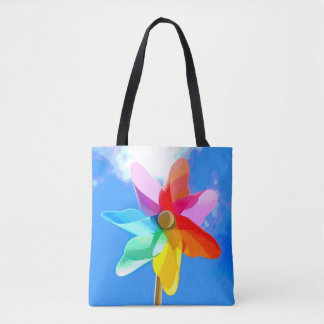 Bag with multicolored windwheel before blue