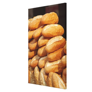 Baguette bread for sale in street by hawker stretched canvas prints