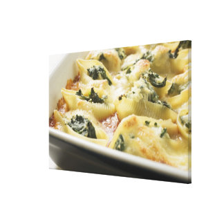 Baked pasta shells with spinach filling canvas print