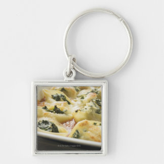 Baked pasta shells with spinach filling key ring
