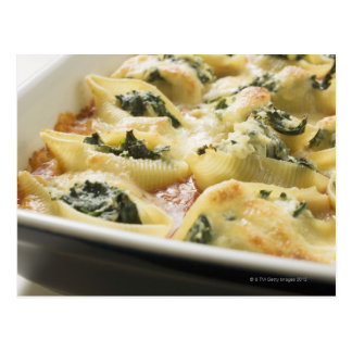 Baked pasta shells with spinach filling postcard