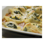 Baked pasta shells with spinach filling poster
