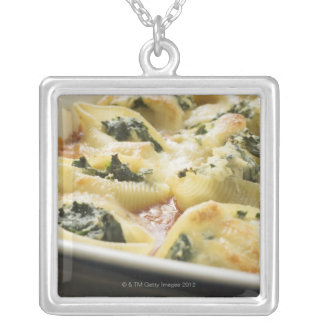 Baked pasta shells with spinach filling silver plated necklace