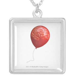 Balloon illustration with a superimposed brain silver plated necklace