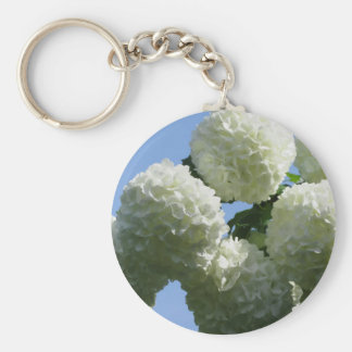 Balls of white hydrangea flowers against the sky basic round button key ring