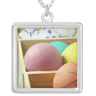 Balls stored in bins silver plated necklace