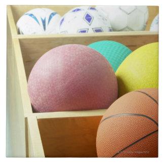 Balls stored in bins tile