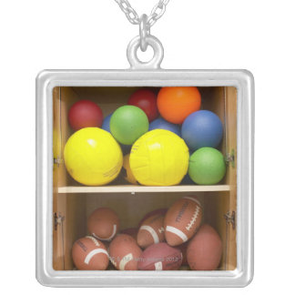 Balls stored in cabinet silver plated necklace