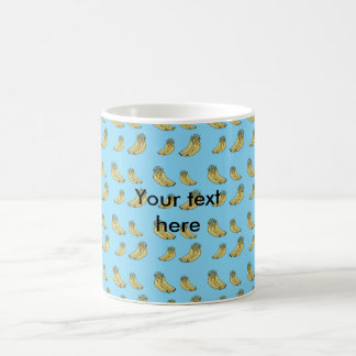 Banana pattern on blue background coffee mug